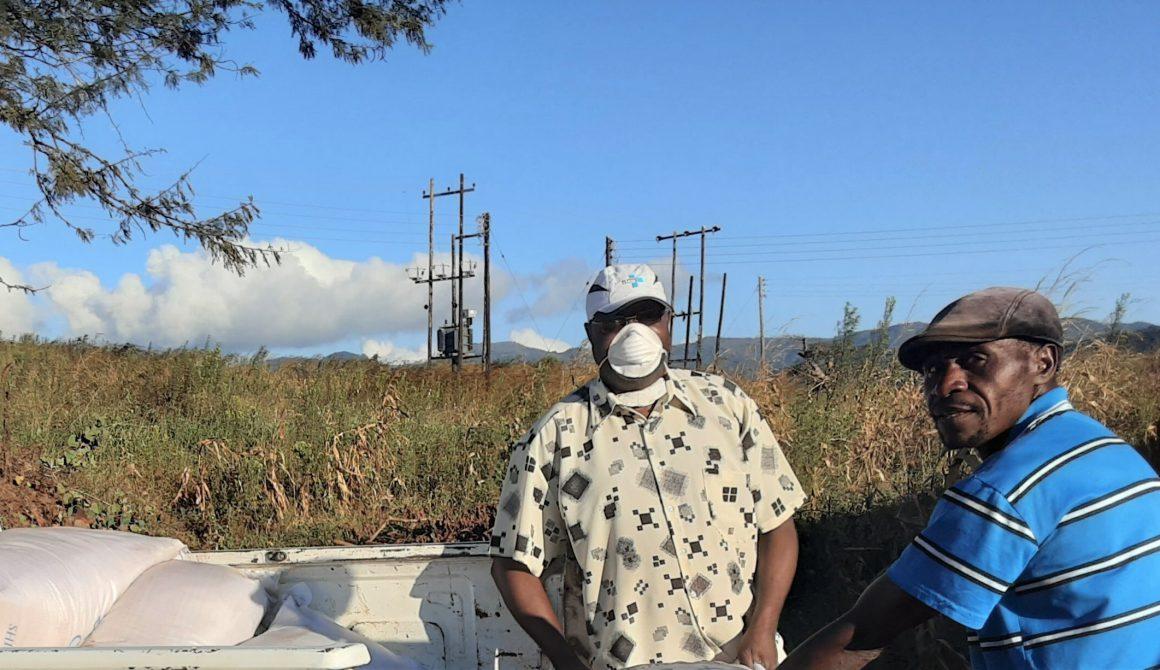 Mutasa South constituency member of parliament MP,Zimbabwe, Regai Tsunga (with mask), distribute food to vulnerable people- Photo courtesy- Regai Tsunga